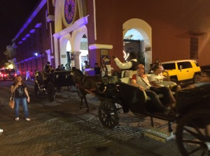 Horse driven carriages can be seen all over the city