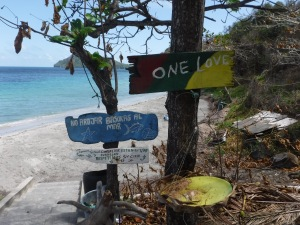 One Love.  Sign says no littering.  Save the fragile creatures