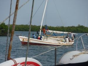 One canoe per fisherman is carried aboard the sailboat.  We see these everywhere.