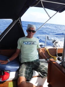 Lounging Bill.  Our lifejackets and harnesses are ready, but there's not much wind or much to do for sail changes.