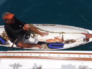 We bought fish from this Belizean fisherman at Rendezvous Cay