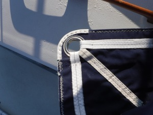 Ullman Sails sewed on this leather and webbing through at least eighteen layers of stiff fabric