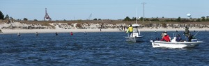 Fishermen fill the beach and channel as we arrive at Beaufort NC.